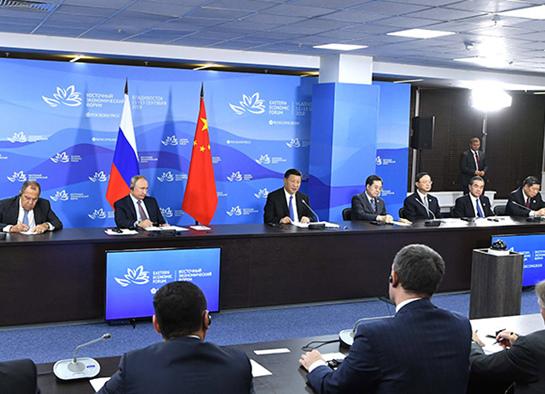 习近平和俄罗斯总统普京共同出席中俄地方领导人对话会