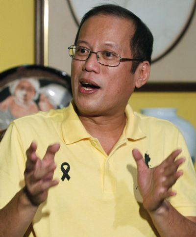 Senator Benigno Aquino III speaks during a news conference at Aquino