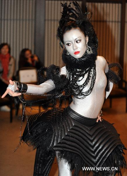 a model presents designed costume for an avant garde musical the lady of the camellias in taipei southeast chinas taiwan dec 28 2010 avant garde meets arabic