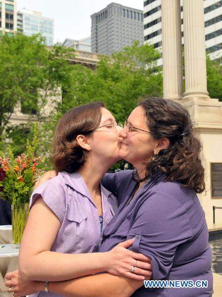 A lesbian couple kiss each other during a wedding ceremony held by the City ...