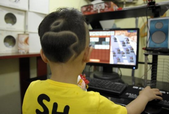 Five Year Old Boy With Apple Pattern Hairstyle Peoples Daily Online