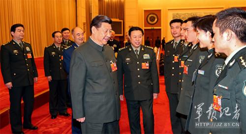习近平接见军队基层人大代表:赞刘洋巾帼英雄