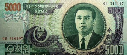 5000元 图案及纸币大小同100元和1000元 (颜色略有不同)正面