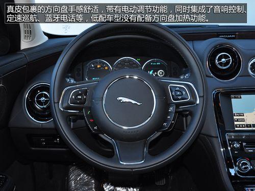 内饰方面 2014款捷豹xj2.0则以大量真皮,桃木和仿铝合 高清图片