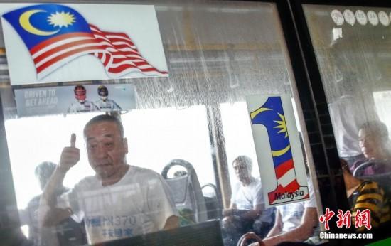 北京 马航/3月30日,一批马航失联客机乘客家属从北京乘机抵达吉隆坡。...