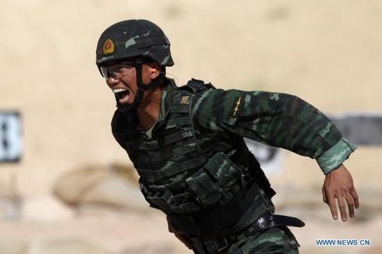 """武警部队代表队於当地时间5月5日在第六届""""勇士竞赛""""国际特种兵比图片"""