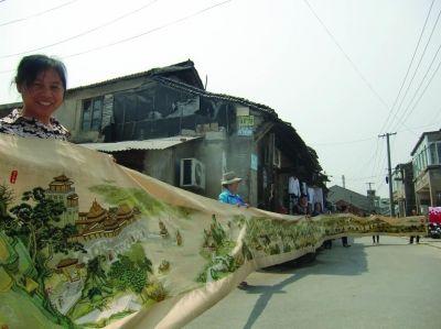 南京市民绣22米长《清明上河图》献礼青奥会