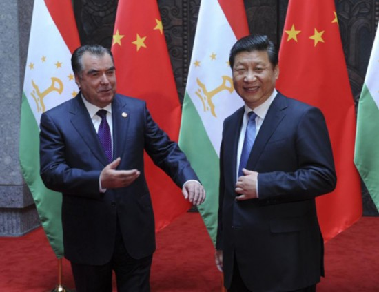 Chinese President Xi Jinping (R) meets with his Tajik counterpart Emomali Rakhmon in Shanghai, east China, May 19, 2014. (Xinhua/Zhang Duo)