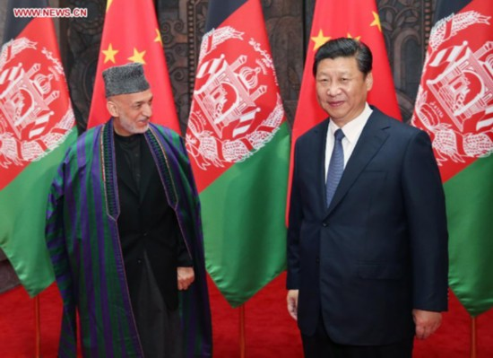 Chinese President Xi Jinping (R) meets with Afghan President Hamid Karzai in Shanghai, east China, May 19, 2014. (Xinhua/Yao Dawei)