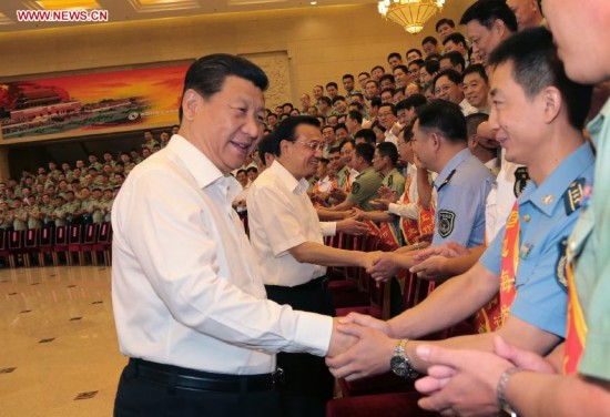 Senior Chinese leaders Xi Jinping, Li Keqiang and Zhang Gaoli meet with representatives attending a national meeting on frontier and coast defense in Beijing, China, June 27, 2014.