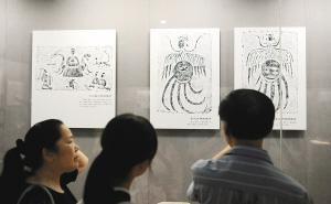 汉代画像砖珍品展吸引市民参观。张宇明摄