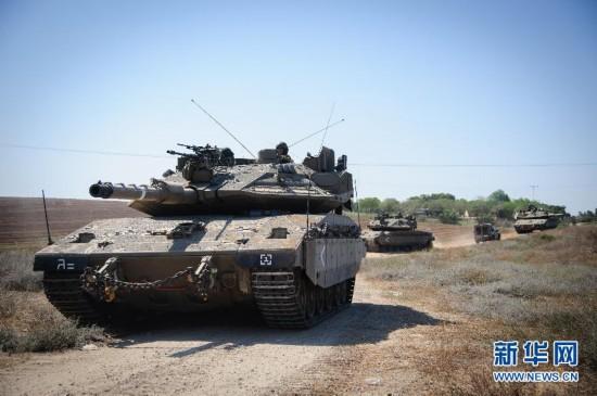 以色列对加沙空袭升级 地面部队在边境集结