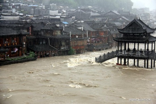 More than 120,000 locals and tourists have been evacuated since Monday night as record downpours hit Fenghuang County, a tourist destination renowned for its ancient town.