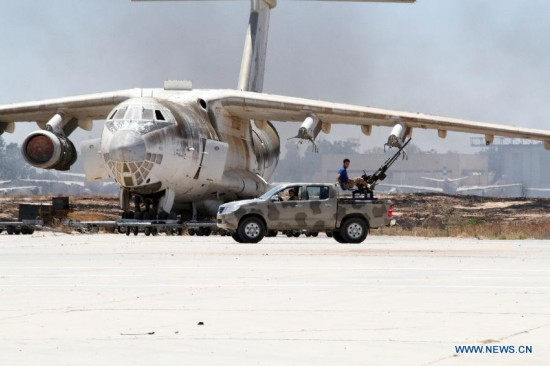 Militiamen in an armed vehicle patrols in Tripoli International Airport, in Libya, on July 16, 2014.