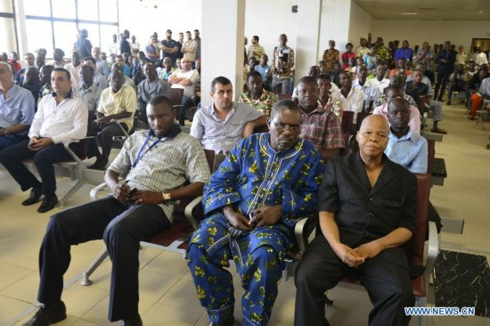 Relatives of victims wait at the international airport of Ouagadougou, Burkina Faso, July 25, 2014.