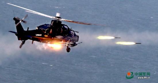 6月14日,广州军区某陆航旅武装直升机在某海域进行实弹射击演练.