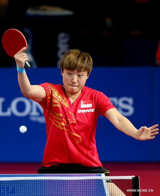 Feng Tianwei of Singapore competes during the women's team final of table tennis against Malaysia's Beh Lee Wei at the 2014 Glasgow Commonwealth Games