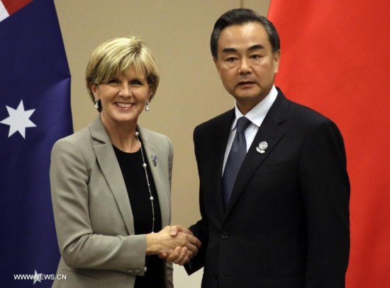Chinese Foreign Minister Wang Yi (R) meets with Australia's Minister for Foreign Affairs Julie Bishop on the sidelines of the series of ASEAN Foreign Ministers' Meetings (AMM) on East Asia cooperation in Myanmar's capital of Nay Pyi Taw on Aug. 9, 2014. (Xinhua/U Aung)
