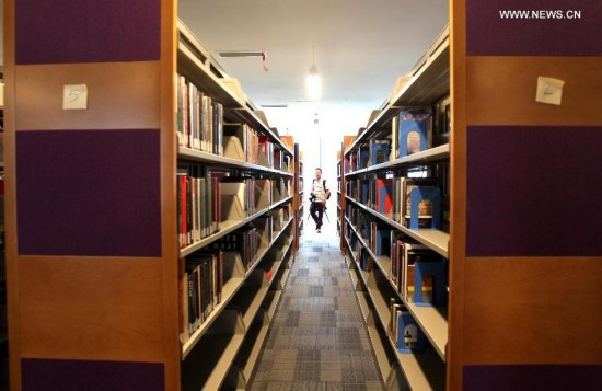 A 24-hour library is seen in an education building in the new campus of New York University (NYU) Shanghai in Shanghai, east China, Aug. 14, 2014.