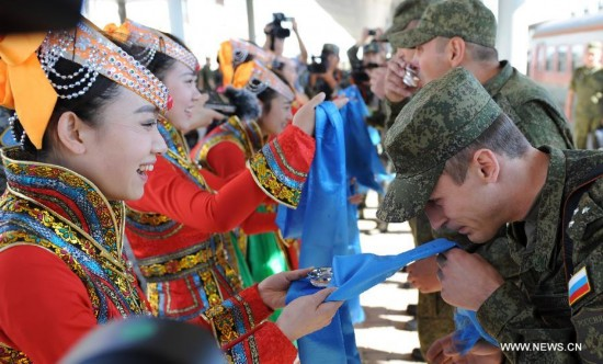 The first Russian army echelon on Saturday arrived at the Zhurihe training base, where 'Peace Mission-2014,' a drill under the Shanghai Cooperation Organization (SCO) framework, will run from Aug. 24-29. The drill, which will involve over 7,000 personnel from China, Russia, Kazakhstan, Kyrgyzstan and Tajikistan, is expected to hone multilateral decision-making, sharpen joint anti-terror efforts and boost intelligence sharing to ensure regional peace and stability.