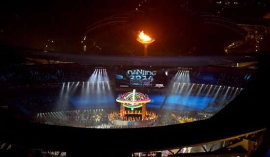 The cauldron is lit up during the Opening Ceremony of the Nanjing 2014 Youth Olympic Games in Nanjing, capital of east China's Jiangsu Province. (Xinhua/Huang Xiaobang)
