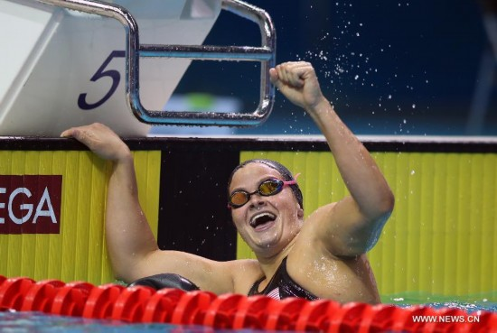 Clara Smiddy(C)of United States of American celebrates during the Women's 100m Backstroke match at Nanjing 2014 Youth Olympic Games