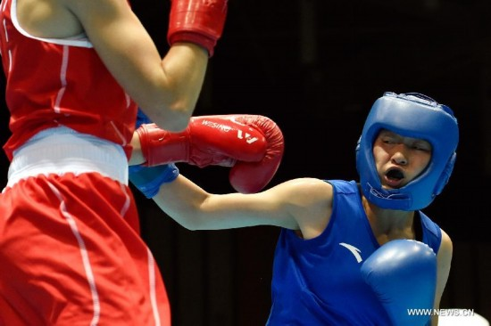 Chang Yuan of China(R)competes during the Women's Fly (48-51kg) Boxing final match at Nanjing 2014 Youth Olympic Games in Nanjing, capital of east China's Jiangsu Province, on Aug. 26, 2014.Chang Yuan of China won the gold medal. G