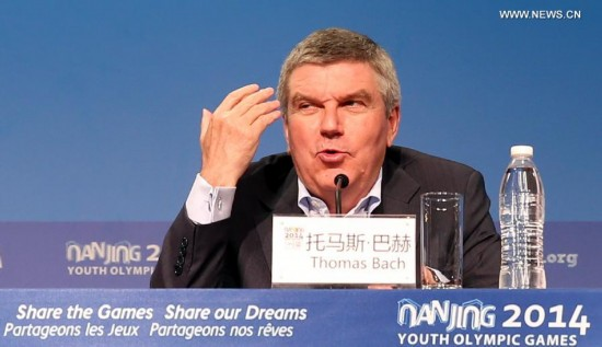 Thomas Bach, the president of International Olympic Committee, speaks during the International Olympic Committee press conference on the last day of Nanjing 2014 Youth Olympic Games in Nanjing, capital of east China's Jiangsu Province, on August 28, 2014.