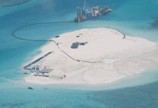菲媒:中国在赤瓜礁上建海港