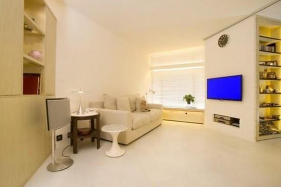 40平小户型装修案例:沙发旁立着大储物柜,敞亮的客厅很清雅,临窗位置