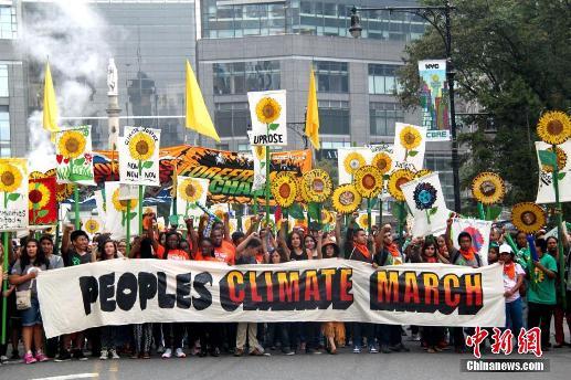 纽约民众游行示威称气候变化华尔街难逃其咎
