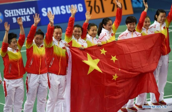 Athletes of China pose on the podium during the awarding ceremonoy of the women's team match of badminton event at the 17th Asian Games in Incheon, South Korea, Sept. 22, 2014. China defeated South Korea 3-0 and claimed the title.