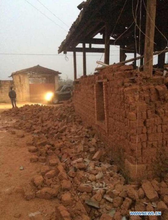 Photo taken with a mobile phone shows the damaged house in Mangfei Village of Yongping Township at Jinggu County of Pu'er City, southwest China's Yunnan Province, Oct. 8, 2014.