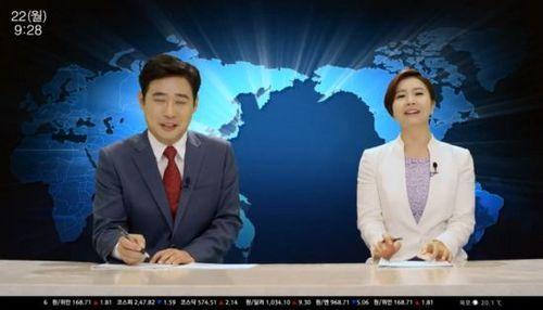 韩国新闻直播事故:女主播连带男主播笑岔气(图)