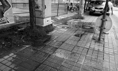海口红城湖附近一大厦污水排到马路上
