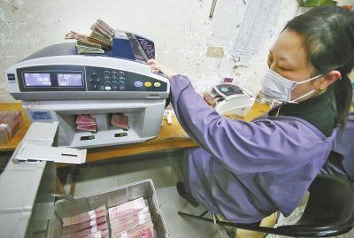 洛阳一企业用残损纸币发电 1吨可发电660度(图)