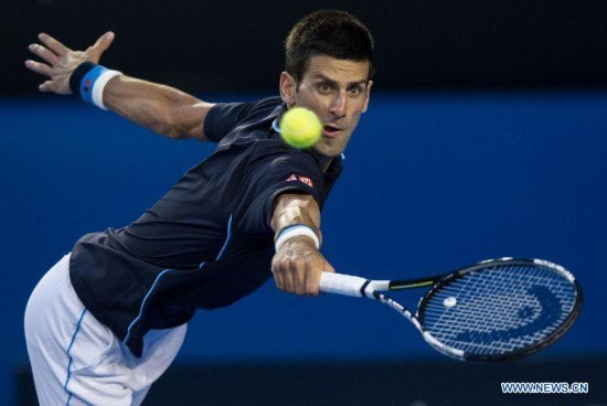 Novak Djokovic of Serbia returns the ball during the men's singles third round match against Fernando Verdasco of Spain at the 2015 Australian Open tennis tournament at Melbourne Park in Melbourne, Australia, Jan. 24, 2015. Djokovic won 3-0. (Xinhua/Bai Xue)