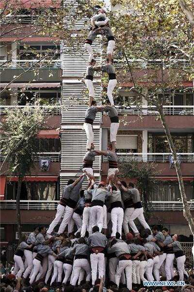 Chinese girl in local Spanish human tower team