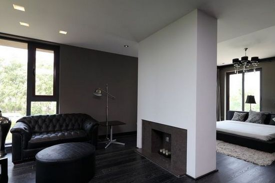 卧室客厅隔断装修效果图5     复古的皮沙发与几何感极强的茶桌