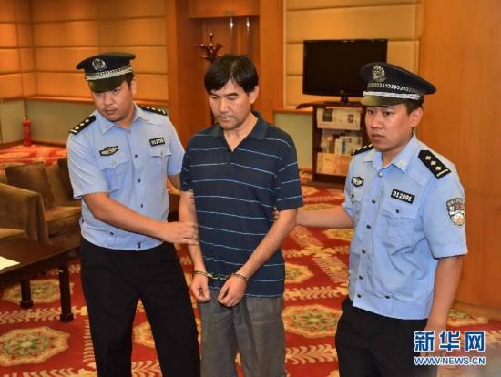 (法制)(4)红色通缉令上网人员原北京市新闻出版局出纳孙新被押解回国