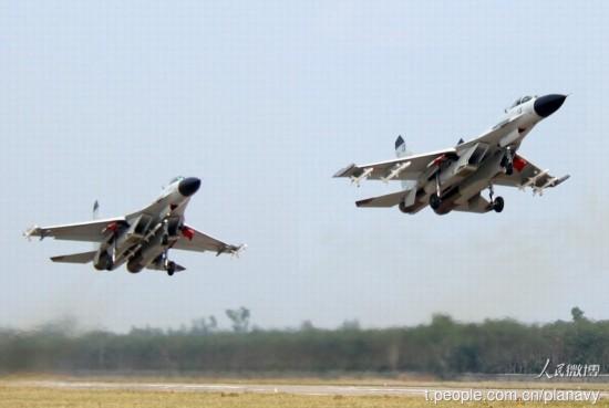 高清:中国舰机在西太海域协同训练