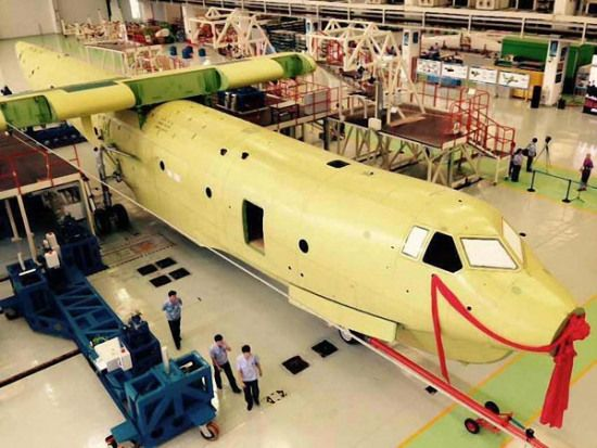 The fuselage of an AG-600, China's self-developed amphibious aircraft, is assembled in Zhuhai, Guangdong province, on Friday. Cao Yanxing / For China Daily