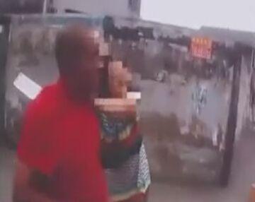 妻子遭家暴持菜刀架丈夫脖子游街 大喊你不懂