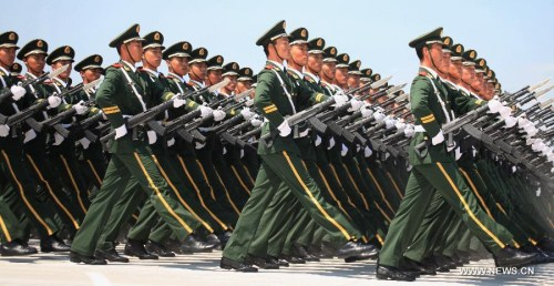 Soldiers take part in a training for a military parade in Beijing, capital of China, July 23, 2015. China will hold a grand military parade on Sept. 3 to mark the 70th anniversary of the victory of the Chinese People's War of Resistance Against Japanese Aggressions and the World Anti-Fascist War. (Xinhua/Tian Feng)