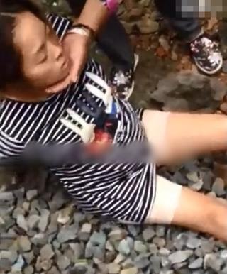 浙江孕妇被绑铁柱上 遭男子肆意暴打(组图)