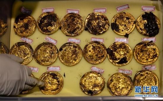 (城乡热点)(3)海昏侯墓出土金饼达285枚 数量为汉墓考古之最