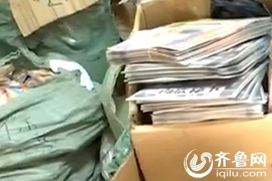 警方在临沂一处门口房查获黄色光碟(视频截图)
