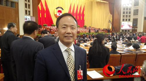 全国政协委员、国家行政学院原副院长周文彰教授