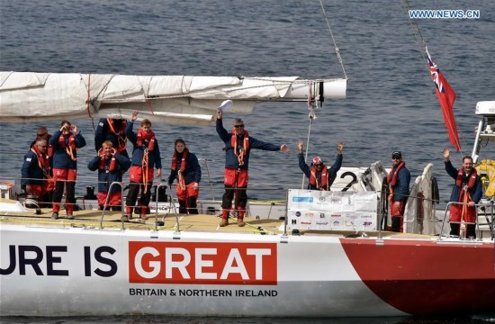 Crew members of Great Britain wave goodbye after setting off for Race 9 at the Clipper 2015-16 Round the World Yacht Race in Qingdao, east China's Shandong Province, March 20, 2016.