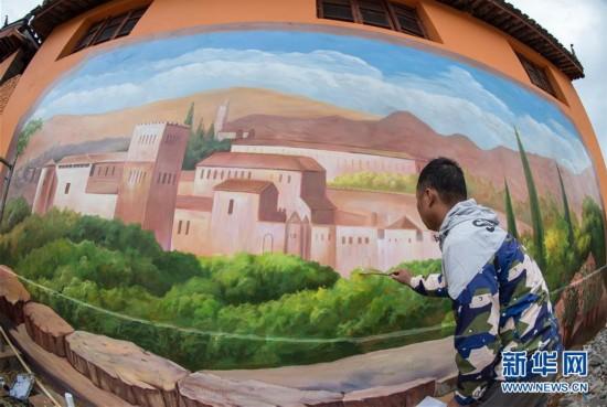 4月27日,画家在金龙村一栋房屋墙上绘制3D立体画。 2015年下半年以来,云南省丽江市七河镇金龙村通过统一规划,为村里的442栋庭院式房屋陆续刷上了9种颜色的彩绘,有的墙壁还画上了大幅的3D立体画,让这个深山坝子中的村落充满了艺术气息。最近,随着彩绘逐渐完成,各地游客纷至沓来,彩色村庄金龙村人气大旺。 据了解,金龙村村民均为外迁来的移民。为实现移民搬得出、留得住、过得好的生活目标,当地通过创新开发旅游项目,带动村民发展致富。 新华社记者胡超摄